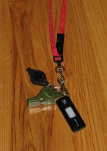 My Fox40 Classic Whistle (in cool camo-color), Photon Freedom LED flashlight, and SanDisk Cruzer on neck lanyard